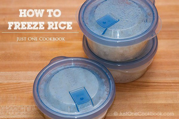 Cooked white rice in a plastic containers.