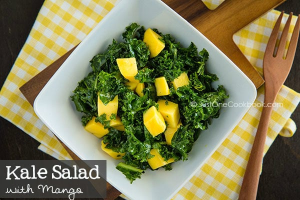 Kale Salad with Mango in a white plate.