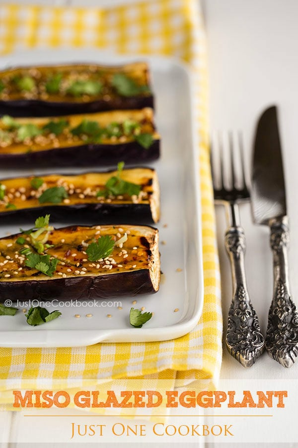 Miso Glazed Eggplant on a white plate.