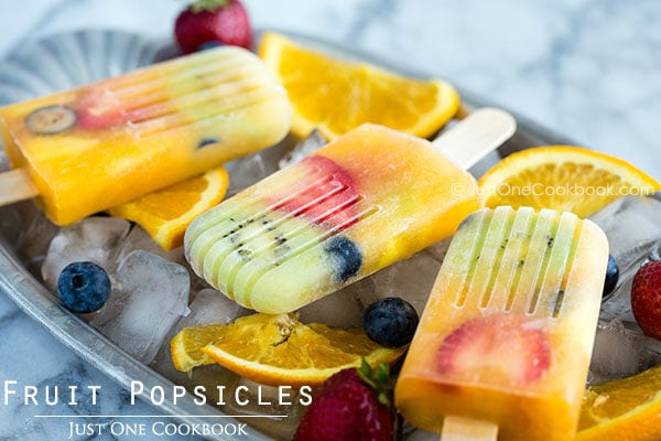 Fruit Popsicles on ice cubes.