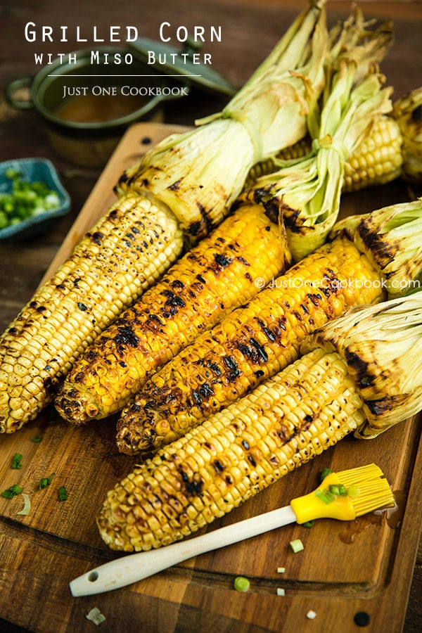 Grilled Corn wtih Miso Butter on a wooden board.