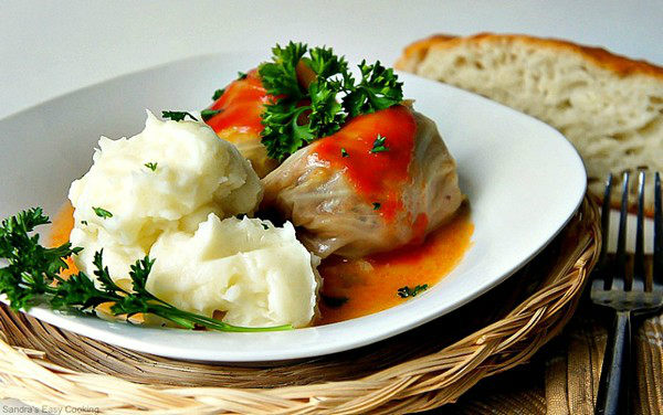 Sour Cabbage Meat Rolls with mush potato on a plate.