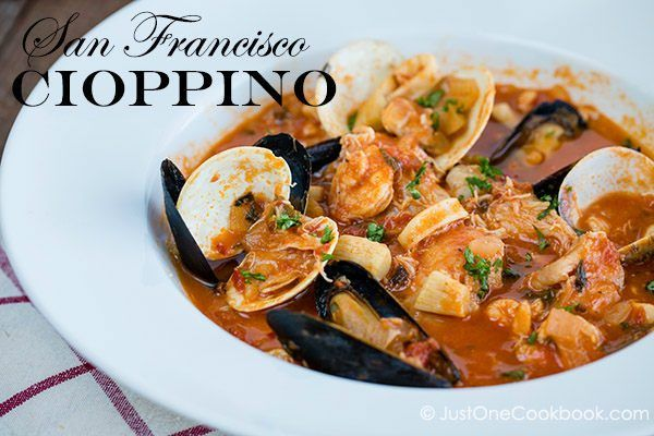 Cioppino in a white soup bowl.