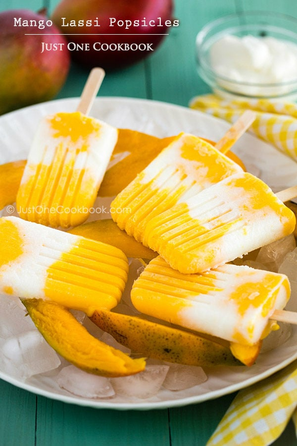 Mango Lassi Popsicles on a plate.