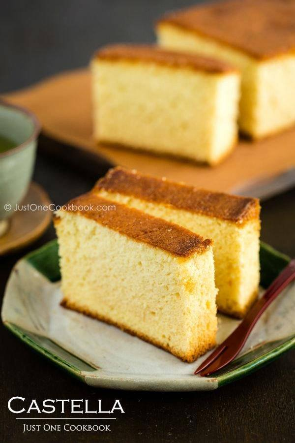 Sliced Castella on the Japanese dish with wooden fork.