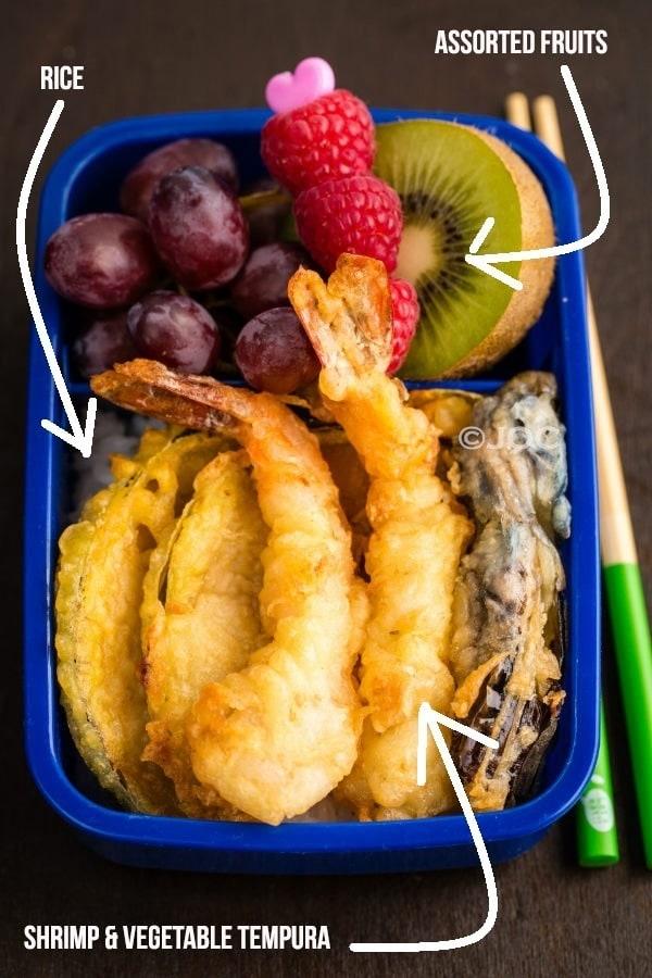 Tempura Bento with tempura, rice and fruits.
