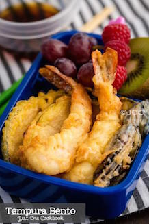 delicious tempura bento box with rice and fresh fruits