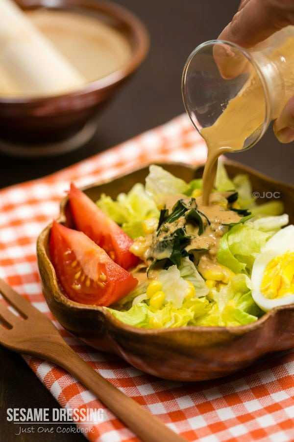 Easy and healthy Japanese Sesame Dressing over green salad.