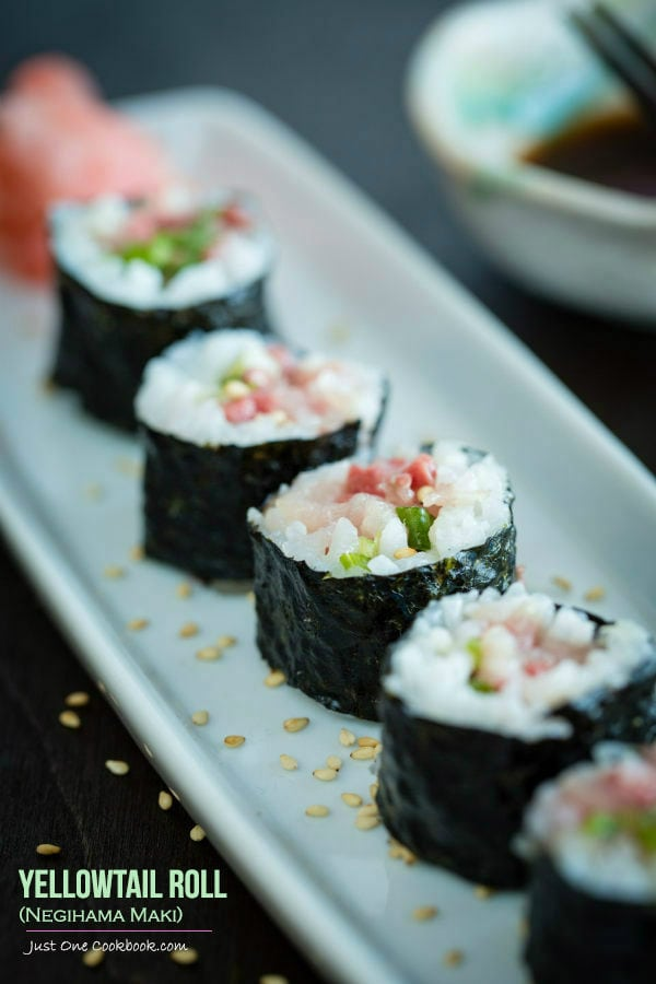 Yellowtail Roll, Negihama Maki on a white plate.