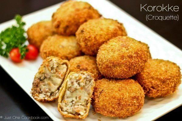 Korokke on a white plate.