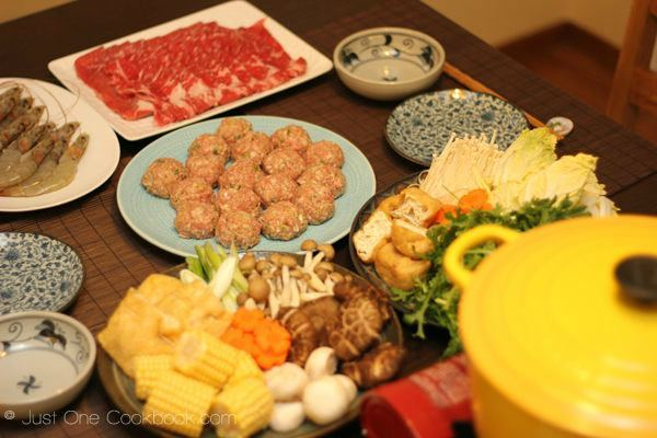 Taiwanese hot pot and homemade meatballs on a table.