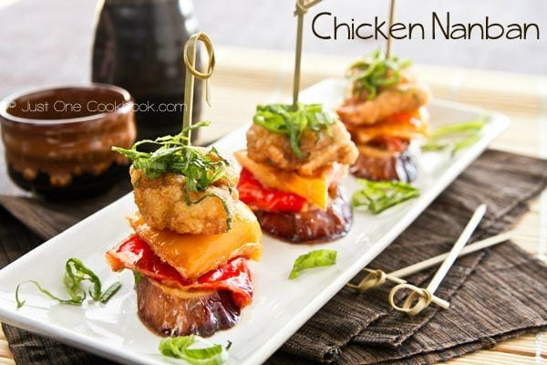 chicken nanban skewers on a white plate