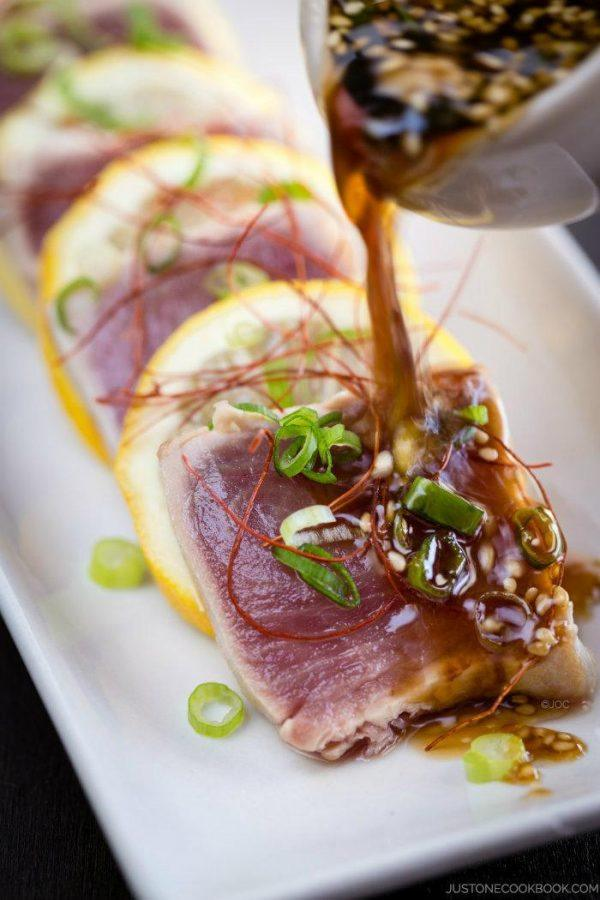 Tuna Tataki with ginger ponzu sauce on a plate.