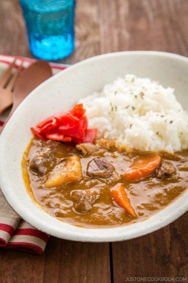 Beef Curry with white rice and pickles.
