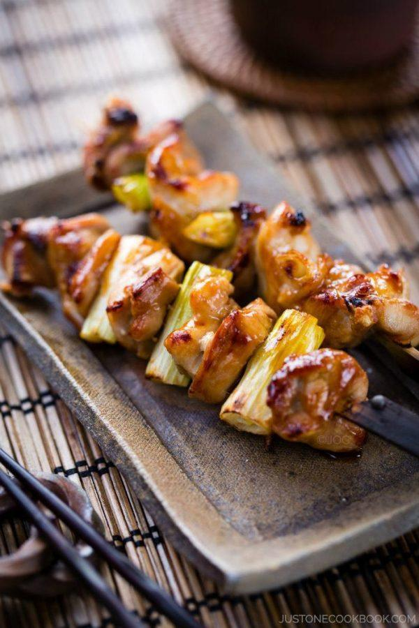 Yakitori, Chicken and Scallion skewers on a plate.