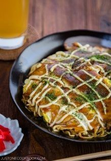 Hiroshima Okonomiyaki on a black plate.