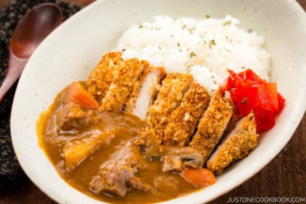 Katsu Curry with white rice in a white plate.