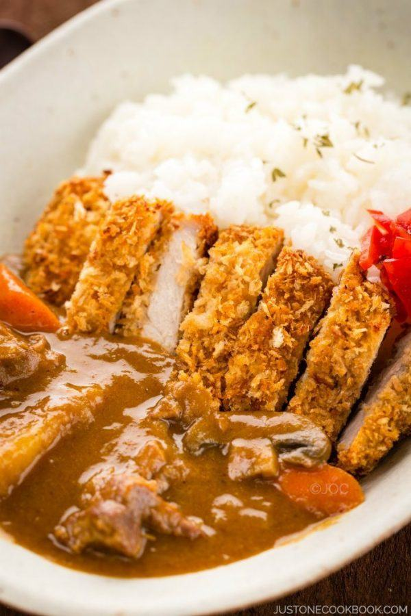 Katsu Curry and white rice in a white bowl.