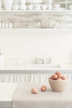 eggs on a counter pot in front of white kitchen