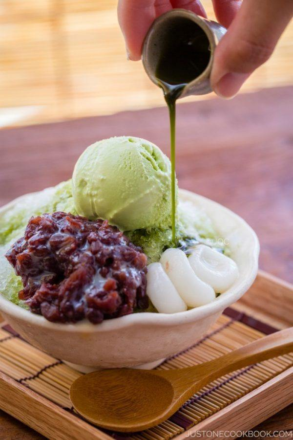 Green Tea Shaved Ice with sweet red bean and green tea ice cream in the bowl.