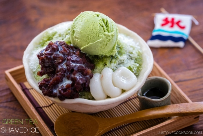 Green Tea Shaved Ice with anko, green tea ice cream and shiratama dango in a bowl.