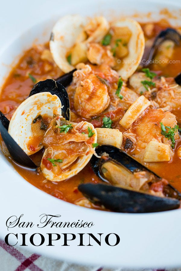Cioppino in a white bowl.
