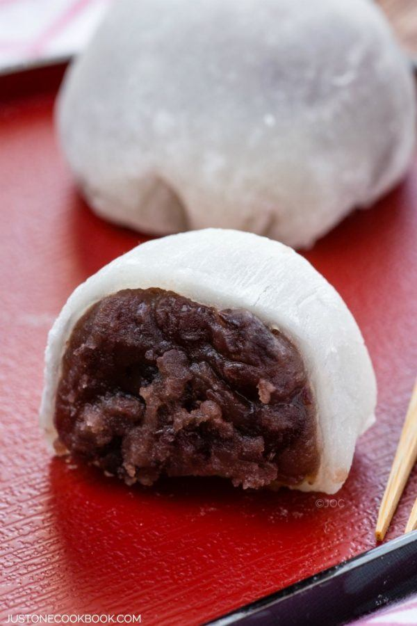 Daifuku Mochi on a red plate.