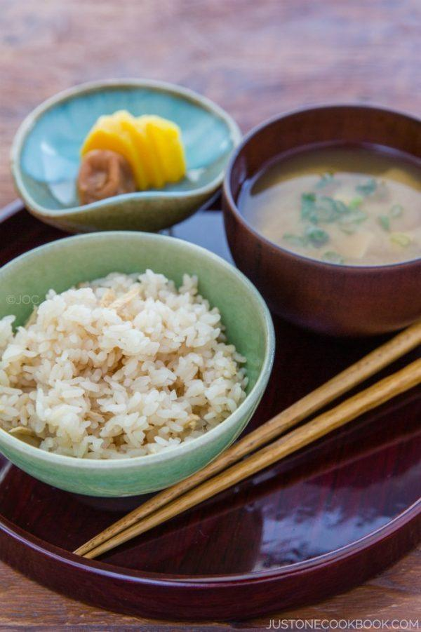 Ginger Rice, miso soup and pickles on a wooden tray.