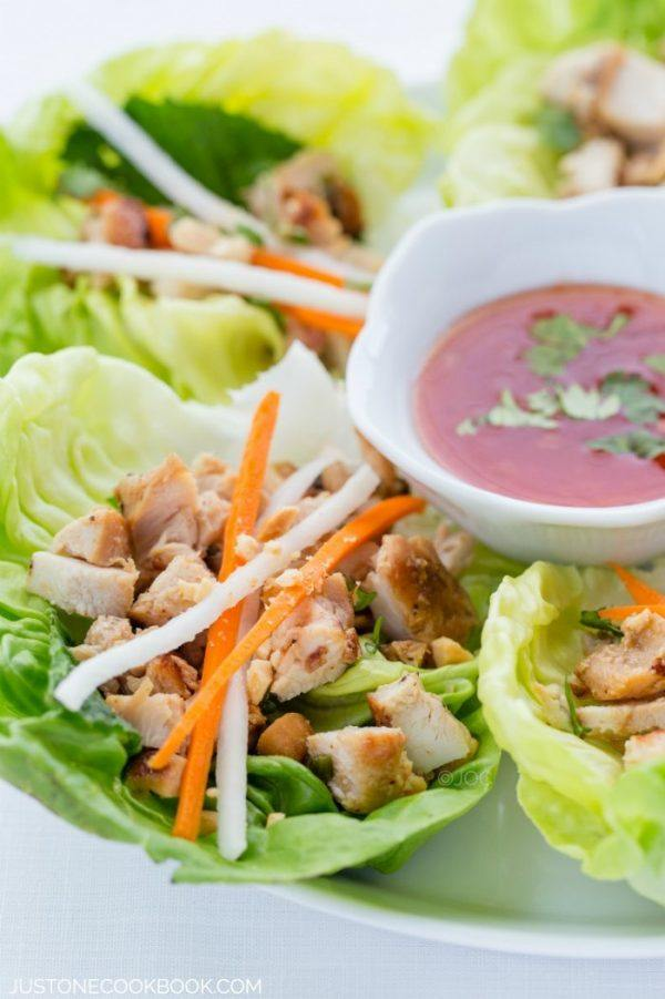 Thai Chicken Lettuce Wraps on a plate with sweet Thai chili sauce.