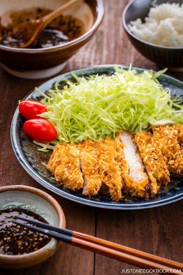 Baked Tonkatsu, Japanese Pork Cutlet and salad on a plate.