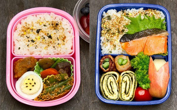 Bento boxes with rice and proteins and vegetables.