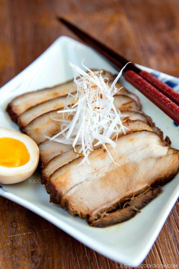 Sliced Chashu on a white plate.