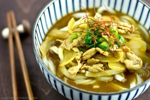 Curry Udon with pork in a bowl.