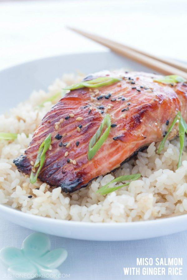 Miso Salmon over the rice in the white plate.