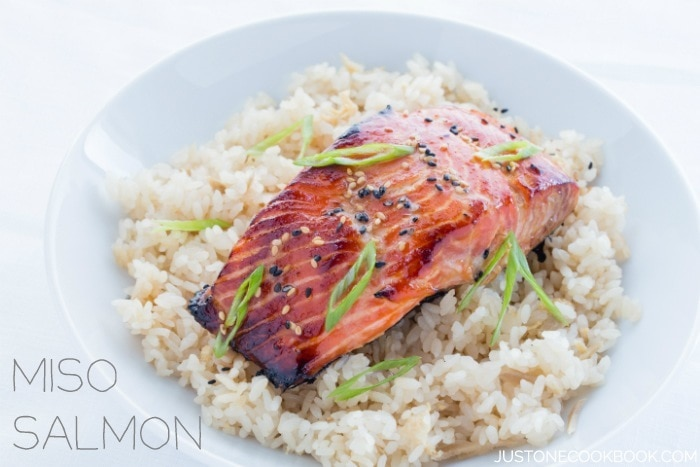 Miso Salmon over rice in a white bowl.