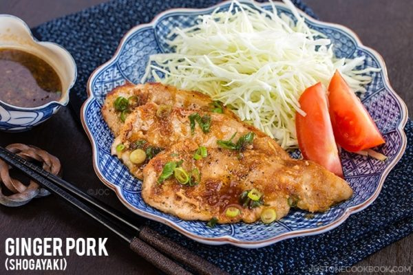 Ginger Pork with cabbage salad on a plate.