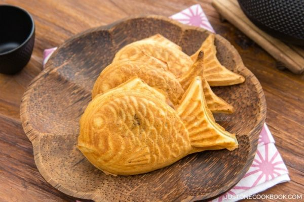 Taiyaki, Japanese fish-shaped cake snack with sweet red bean filling on the plate.