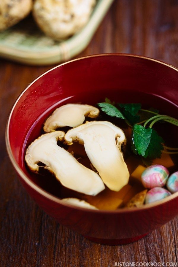Matsutake Clear Soup in Japanese soup bowl on wooden table.