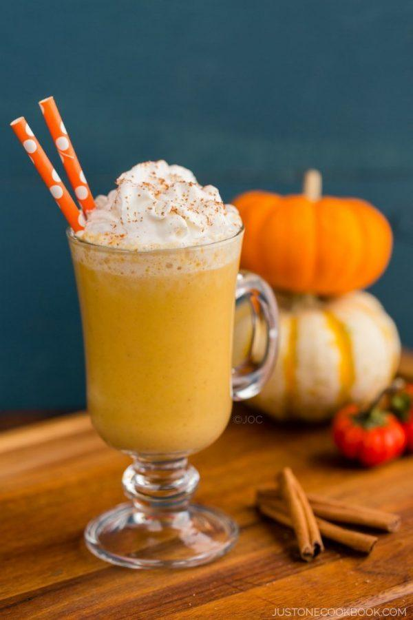 A glass of Pumpkin Smoothie with whipped cream on top.