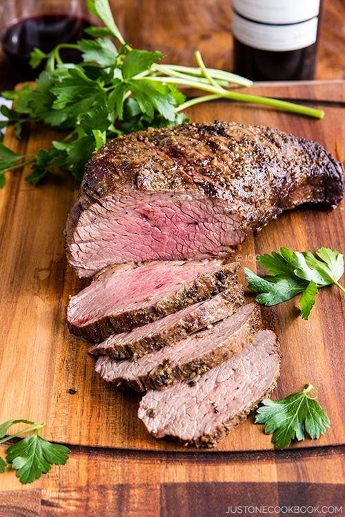 Tender and Juicy Wood-Smoked Tri-Tip on a cutting board.