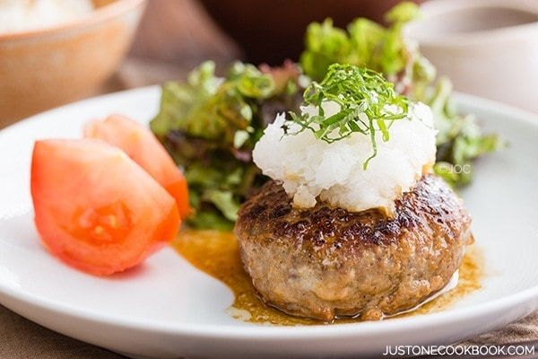 Japanese Hamburger Steak with salad on a plate.