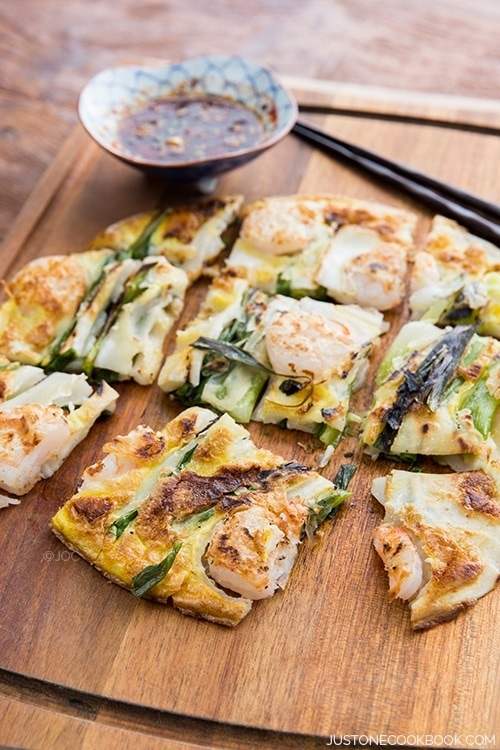 Scallion & Prawn Korean Pancake on a cutting board.