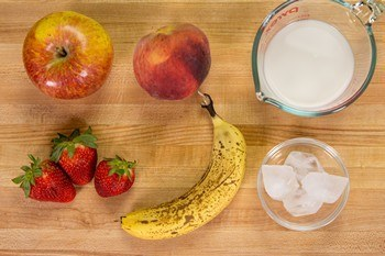 ingredients for Strawberry Banana Smoothie on cutting board