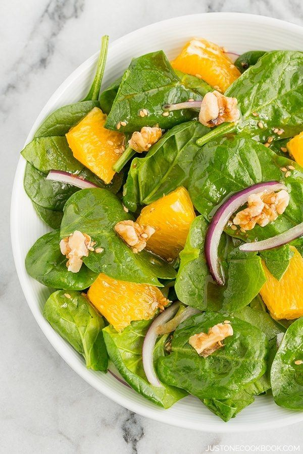 Spinach Salad with Asian Salad Dressing on a plate.