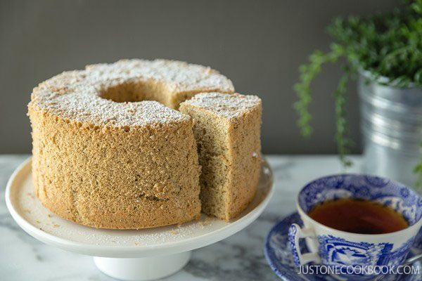 Earl Grey Chiffon Cake on a cake stand and a cup of tea.