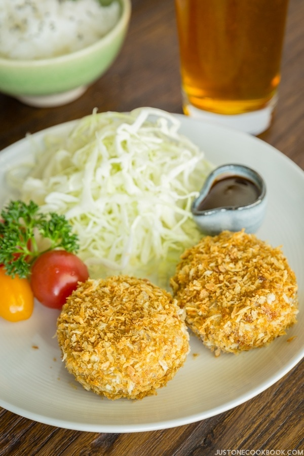 Baked Croquette and salad on a plate.