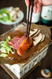 Hoba Miso with Beef on a BBQ grill.