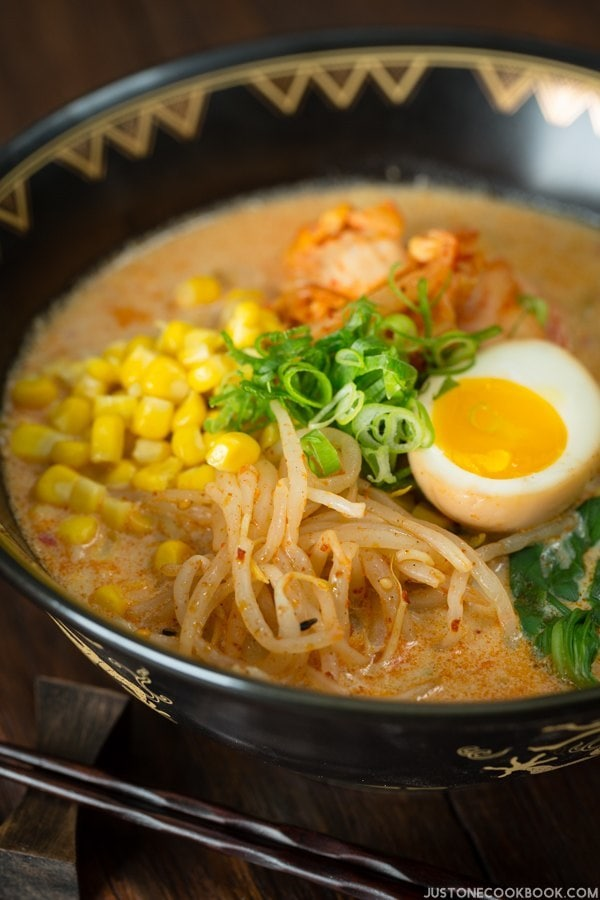 Vegetarian Ramen topped with ramen egg, spicy bean sprouts and sweet corn in a bowl.