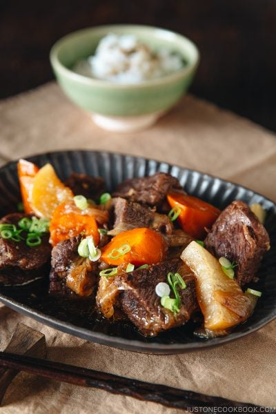 Pressure Cooker Short Ribs on a dark plate.