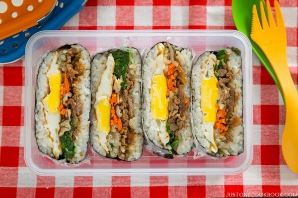 Bulgogi Onigirazu in a lunch box.